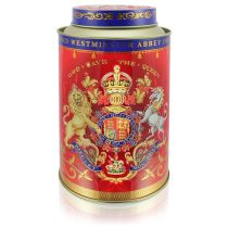 Coronation Tea caddy featuring the lion and unicorn royal coat of arms surrounded by gold ornamental features on a red background. Contains 50 tea bags and is Commemorative of Her Majesty The Queen's Coronation day.