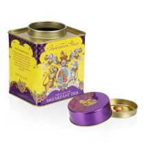 yellow and purple breakfast tea tin displaying the crest of arms with the lid off and next to the tin