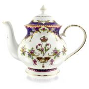 Queen Victoria fine bone china teapot with a design featuring Queen Victoria's name cipher and a coronet surrounded by floral patterns and gold plated rims.