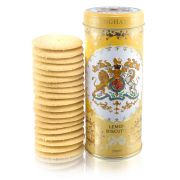 yellow tin with floral decoration and the crest and the centre of the tin. Stood next to a pile of lemon biscuits