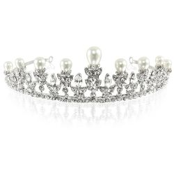 Pearl and crystal metal tiara featuring pearls embeded on top of the spikes and sparkling crytals embeded over an intricately ornated band .