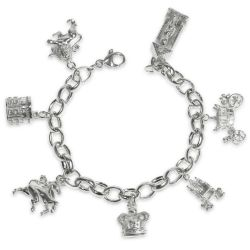 19 cm sterling silver charm bracelet with 7 different charms symbolising the British Monarchy including a throne charm, Guardsman charm, carriage charm, Windsor Castle tower charm, crown charm, lion charm and unicorn charm.