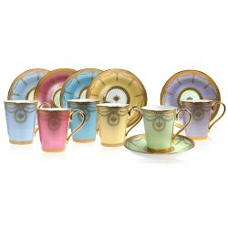 The full Imperial Russian cup and saucer set displayed in a gift box with a design featuring gilded borders and ornated gold patterns in 6 individual pastel coloured backgrounds. Green, yellow, turquoise, pink, blue and purple.