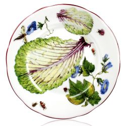 Chelsea Porcelain salad plate with a design featuring botanical patterns.