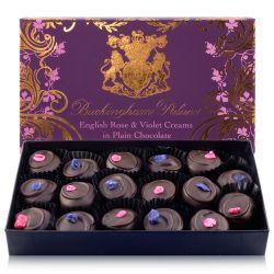 Buckingham Palace branded English rose and violet creams displayed in a ornated gift box and containing 17 individually wrapped chocolates.