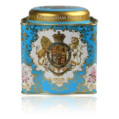 Buckingham Palace Coat of Arms Royal Tea caddy featuring a lion and unicorn royal crest surrounded by ornated gold patterns and english rose patterns on a turquoise blue coloured background. The lid has the words Buckingham Palace, Windsor Castle and Pala