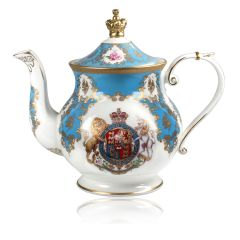 Royal coat of arms English fine bone china 6 cup Teapot featuring a lion and unicorn royal crest surrounded by ornated gold patterns and English flower patterns on a turquoise blue coloured background. The lid is topped with with a royal gold crown.