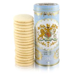 blue biscuit cylinder tin with crest on the front. Stood next to a pile of shortbread biscuits