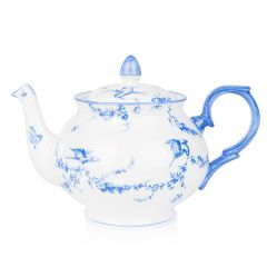 A white teapot with blue floral garland and bird design.