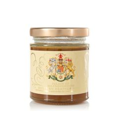Glass jar of honey with gold lid. The jar is wrapped with a label displaying the Scottish Coat of Arms