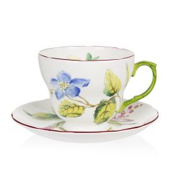 Chelsea fine bone china teacup and saucer with a design featuring  botanical paterns on both pieces and in the inner side of the cup.