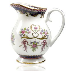 Queen Victoria fine bone china cream jug with a design featuring Queen Victoria's name cipher surrounded by floral patterns and gold plated rims.