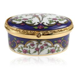Queen Victoria fine bone china hinged box with a design featuring Queen Victoria's name cipher surrounded by floral patterns and an engraved gold plated hinge. A coronet and a flower patern also decorate the inside of the box.