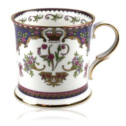 Queen Victoria Tankard with design featuring Queen Victoria's name cipher surrounded by floral patterns and gold plated rims.
