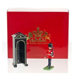 Scotsguard with gun and sentry box metal figure set with individual  gift box. The sentry box is gloss black with golden rims on the front part and the guardsman figure stands next on a green platform support.