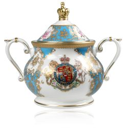Royal coat of arms English fine bone china sugar bowl featuring a lion and unicorn royal crest surrounded by ornated gold patterns and English flower patterns on a turquoise blue coloured background. The lid is topped with with a royal gold crown.