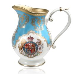 Royal coat of arms fine bone china cream jug featuring a lion and unicorn royal crest surrounded by ornated gold patterns and English flower patterns on a blue coloured background.