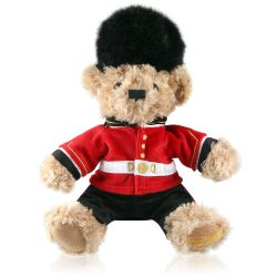 Royal Guardsman Teddy Bear plush toy for children featuring a scotsguard uniform and bearskin hat inspired on The Queen's Guards livery at Buckingham Palace.
