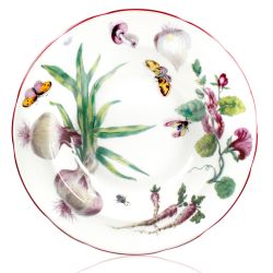 Chelsea Porcelain soup plate with a design featuring botanical patterns.