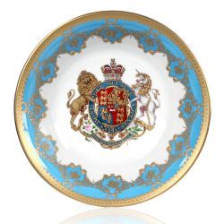 Royal coat of arms fine bone china footed bowl featuring a lion and unicorn royal crest surrounded by ornated gold patterns and English flower patterns on a blue coloured background. Gilded and decorated on the inner and outer side.