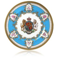 Royal coat of arms English fine bone china dinner plate with gilded rims and featuring a lion and unicorn royal crest surrounded by ornated gold patterns and English flower patterns on a blue coloured background.