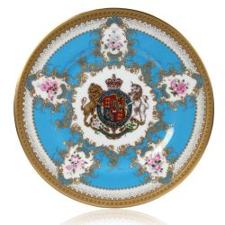 Royal coat of arms English fine bone china salad plate with gilded rims and featuring a lion and unicorn royal crest surrounded by ornated gold patterns and English flower patterns on a blue coloured background.
