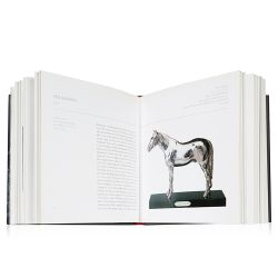 The front cover and open book view of Faberge's Animals, A Royal Farm in Miniature by Caroline de Guitaut.