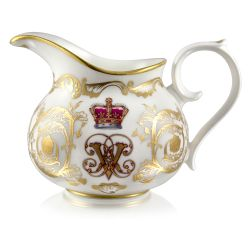 Victoria and Albert English fine bone china cream jug featuring the ciphers of Queen Victoria and Prince Albert surmounted by a royal crown and surrounded by intricately ornated gold patterns.
