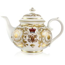 Victoria and Albert English fine bone china teapot featuring the ciphers of Queen Victoria and Prince Albert surmounted by a royal crown and surrounded by intricately ornated gold patterns.
