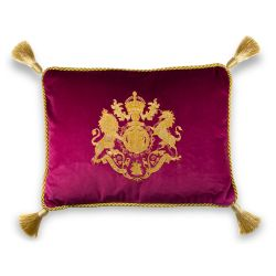 Buckingham Palace pink velvet cushion featuring an embroidered royal coat of arms with golden rope borders and tassels in each corner.