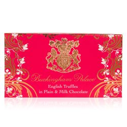 pink box of chocolate truffles with a gold swirl design and the crest at the centre of the design