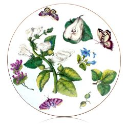 Circular table mat depicting design of leaves, flowers, pears and butterflies