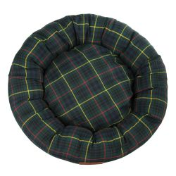 Tartan circular dog bed with a brown leather tag sewn to the front engraved with the words 'Buckingham Palace'