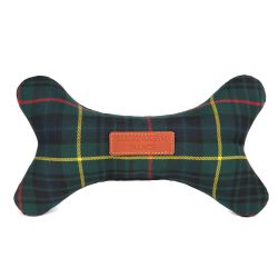 green tartan dog toy in the shape of a bone. A leather tag printed with 'Buckingham Palace' is stitched on