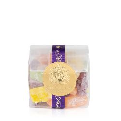jelly babies in a clear bag with a purple ribbon and a gold seal