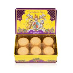 Open purple and yellow tin of shortbread biscuits. The lid features the lion and unicorn crest