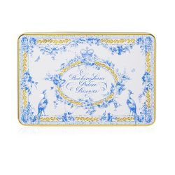 Open rectangular tin of shortbread biscuits.  A white tin with a blue and gold floral garland and bird design