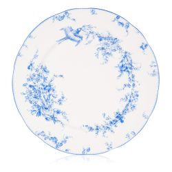A white dinner plate with a blue floral garland and bird design