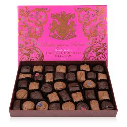 open box of chocolate selection in a pink box with gold swirl