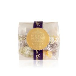 packet of jelly babies wrapped in a purple ribbon and sealed with a gold 'Windsor Castle' sticker