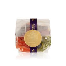packet of wine gums wrapped in a purple ribbon and sealed with a gold 'Windsor Castle' sticker