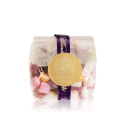 packet of dolly mixtures wrapped in a purple ribbon and sealed with a gold 'Windsor Castle' sticker