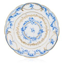 White dinner plate with a blue floral garland and bird design and finished with gold detail and gold edge of the dinner plate