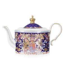 Purple teapot with the Longest Reining Monarch design. With the lion and unicorn crest, gold crown lid and white handle and spout