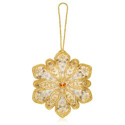 gold and silver beads embroidered on a snowflake decoration with a red and gold crown at the centre