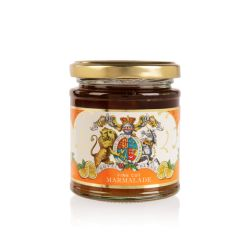Glass jar of marmalade with a gold lid. Wrapped with an orange and white label showing the lion and unicorn crest