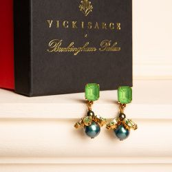 Green crystal stud with a green faux pearl drop topped with green crystal.