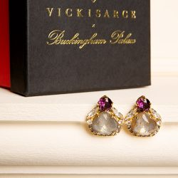 Stud earrings with a purple crystal on a grey enamelled crystal, surrounded by clear crystals