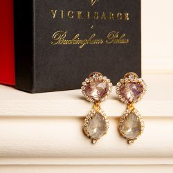 Purple and grey crystal drop earrings surrounded by small clear crystals