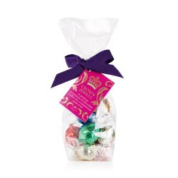 Bag of colourfully wrapped chocolates in a clear bag and wrapped with a purple ribbon